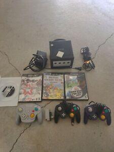 Nintendo Gamecube + wavebird + 2 controllers + 4 Games