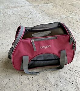 small pink kitten carrier with cushion, pockets and handles