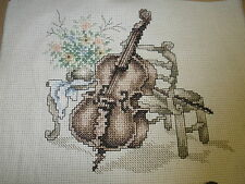 finished counted cross stitch   MUSIC-CELLO ON CHAIR WITH TABLE OF FLOWERS