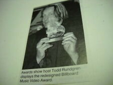 Todd Rundgren holding music video award 1995 music biz promo pic with text