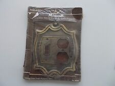 Monticello duplex receptacle & switch plate. Antique brass finish, circa 1982