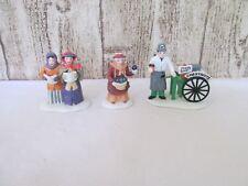 Lot of Department 56 figures Christmas village carolers chestnut wagon