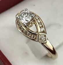 DIAMOND RING 14K GOLD SET WITH 0.30 CARAT IN THE MIDDLE AND 0.34 CARAT AROUND