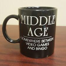 Funny Humor Middle Age Black Coffee Mug Between Video Games and Bingo
