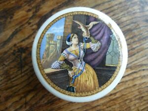 A SMALL SIZE VICTORIAN POLYCHROME POT LID LADY WITH HAWK