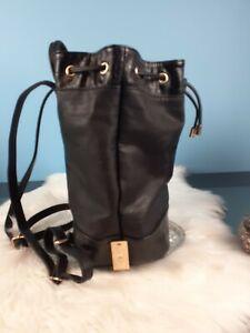 Colette by Colette Hayman | Black Faux Leather Crossbody Bucket Backpack