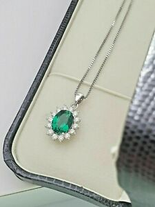 White gold finish green emerald and created diamond oval pendant necklace