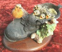 Border Fine Arts  Robin with chicks nesting in an old black boot. R J Ayres