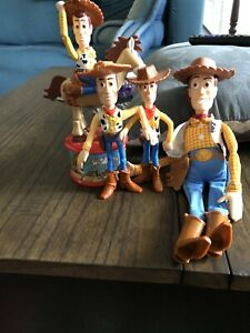 Lot of 4 Woody figures from Toy Story