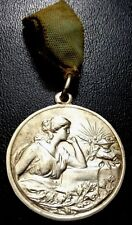 URUGUAY SACRED HEART SCHOOL ART NOUVEAU SEATED LADY, WHITE MEDAL / M92