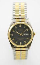 Armitron Watch Mens Day Date Stainless Gold Silver Stretch 30m Black Quartz