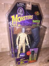 UNIVERSAL MONSTERS THE MUMMY FIGURE WITH FRANKENSTEIN LEG
