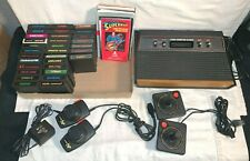 HUGE Vintage ATARI 2600 Game system console Joystick Paddle 31 GAME Manuals LOT