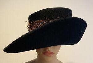 PHILIP TREACY Black felt hat with brown zebra feathers