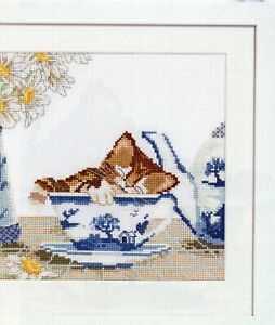 SLEEPY KITTEN IN TEACUP CROSS STITCH PATTERN BY CLAIRE COMERFORD