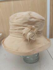 Ladies hat. Biege/custard cloche water resistant hat with detachable flower.
