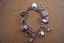 VINTAGE HALLMARKED 1970 CHARM BRACELET  WITH 10 CHARMS 78 GRAMS