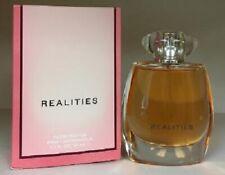 Realities Woman 1.7 oz edp spray NIB -c