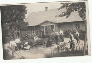 Russia Latvia RPPC Latvian House with family working at garden c 1910-20