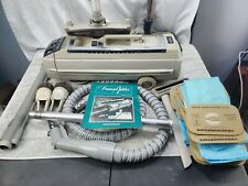 Electrolux Diamond Jubilee Vacuum + extra accessories and 17 New Bags Manual