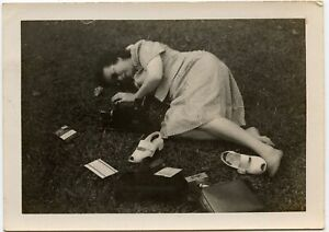 WOMAN RELAXING ON THE GRASS WITH HER CAMERA SHOES ODD VINTAGE SNAPSHOT PHOTO