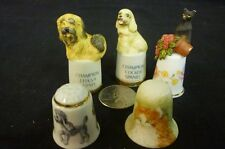 Three Dogs and Two Cat Thimbles
