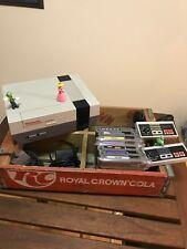 Nintendo NES Console Bundle, 7 games (Super Mario Bros 1, 2, 3), 2 controllers