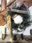 Early Primitive wreath~Early goods~Old Leather Gun~Deer Horn~Flag