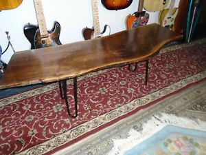 "Coffee Table Walnut ( Live edge ) Measures 17 "" x 52 "" Black metal legs"