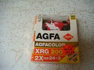 AGFA film box with toy car