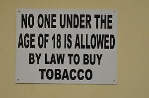 White plastic shop sign printed black no one under 18...tobacco HOLED, DRILLED
