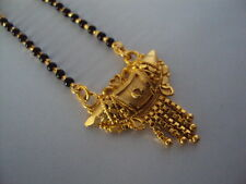 "Black-beaded Gold Plated Wedding Bridal long Mangalsutra chain (24"")."