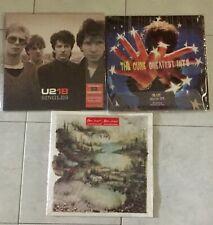 Vinyl ( The Cure greatest hits, U2 18 singles, Bon Iver self-titled)