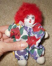 Stuffed clown figurine with painted resin head