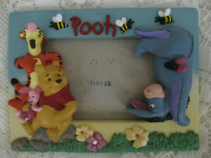 "DISNEY W.POOH & FRIENDS PHOTO FRAME.8"" X 5.5""APPROX POTTERY.GC USED."