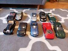 10 Bburago Modellautos Konvolut 1:18, BMW, Corvette, Porsche, Mercedes Jaguar