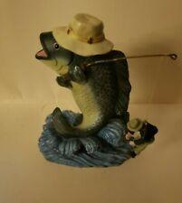 Fish Fishing Catches Man Statue