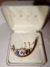 Vintage 1980's Törq multicoloured crystal gold-tone brooch in original box