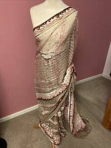 Vintage Cream Net Saree With Matching Blouse