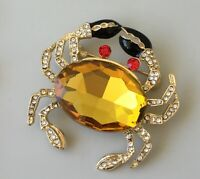 Unique crab pin brooch in  gold tone metal with glass/crystals