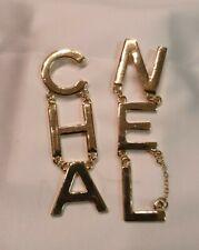 orecchini oro giallo scritta cha nel, cc, logo, firma, fashion