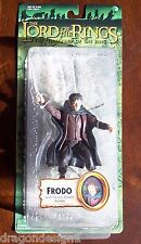 LOTR. FELLOWSHIP OF THE RING. FRODO W/ SWORD ATTACK ACTION. NEW ON CARD