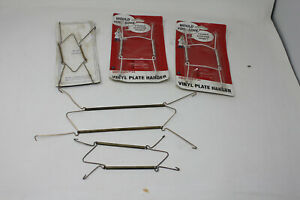 5 Decorative Plate Hangers :  Vinyle and metal Lot