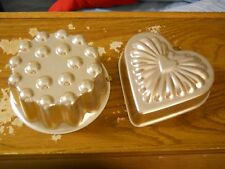 2 copper colored cake or pastry type molds, moulds, forms, or pans