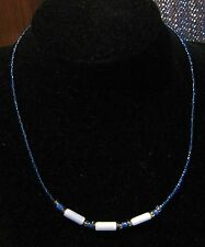 Very pretty single string necklace of blue mini beads with longer beads