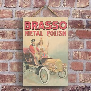 A CLASSIC BRASSO RETRO STYLE VINTAGE ADVERTISEMENT ON A WOODEN PLAQUE