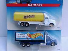 Hot Wheels 1996 (2) McDonald's Haulers (a) Milk Duds (b) Hot Wheels Racing