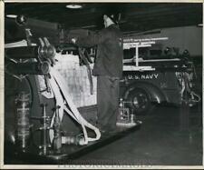 1947 Press Photo worker checks Firland Sanatorium fire fighting supplies Seattle