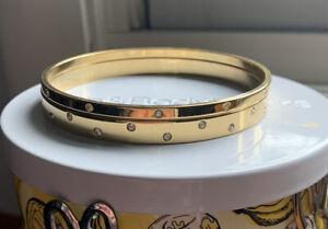 SWAROVSKI Gold Tone and Crystals Bangle Bracelet Signed with Swan Logo Set Of 2