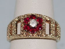 10k God ring with Rubies(July birthstones) and a CZ